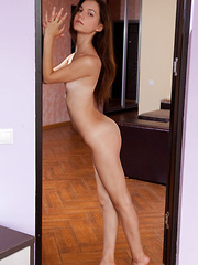Iva sensually poses on the bed as she bares her petite body.