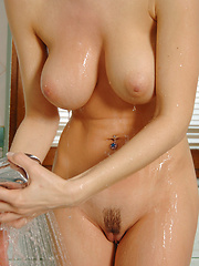 Goddess Jenya alone with the camera and she has to wash up because she is just too hot.