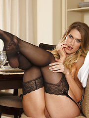 Alexandra spreads her long legs open to fuck her pussy