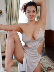 Blessed with enviable flexible body and well-endowed assets, Sofi gracefully poses in her sexy long gown that perfectly hugs her beautiful, large breasts and plump butt.