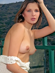 Seductive Tatyana sitting on the terrace exposing her gorgeous, small tits