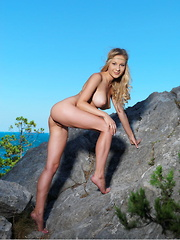 Candice B's stunning beauty, along with her slim body and well-endowed assets, makes a breathtaking view against the azure, cloudless sky.